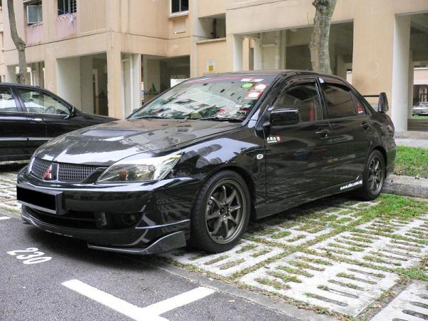 "CF bonnet, Front diffusers, 16"" CE28 replica rims, Tomei coilovers, Sticker eyelids..."